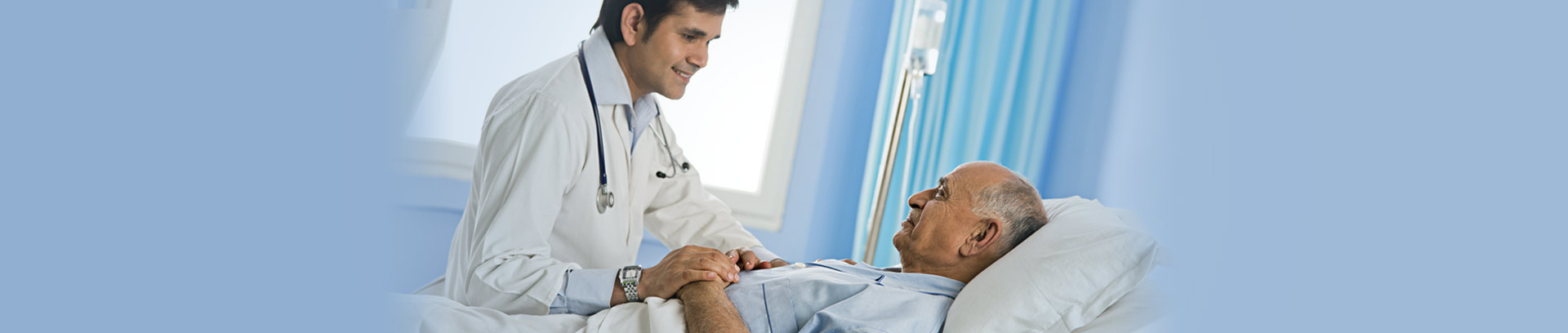 Doctor examines cancer patient to give moral support for recovery